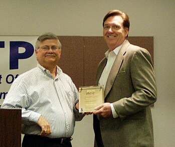 On the right, Gary Cowsert, CIO, Activant, receives his IT Executive of the Year award from Neogent's Steve Bankhead