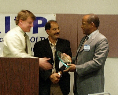 On the right, Fred Mapp, CIO, Advanced Micro Devices, receives his National IT Influence Award from Awards Chairman Scott Calvin and AITP President Bobby Afshin