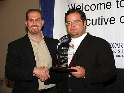 On the right, Tony Alagna, CTO, WholeSecurity is honored as Austin's Information Technologist of the Year by Momentum Software's Scott Campbell