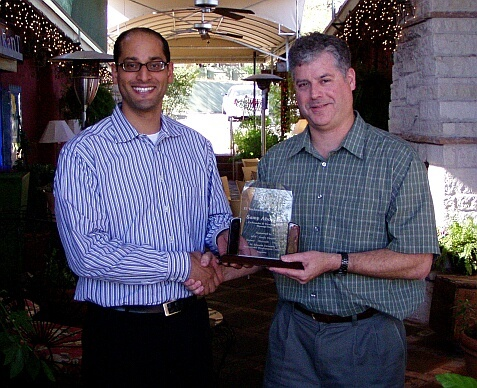 On the left, Samy Aboel-Nil, Co-founder and the Vice President of Product Technology for MessageOne is honored as Austin's Information Technologist of the Year by AITP President Keith Stone